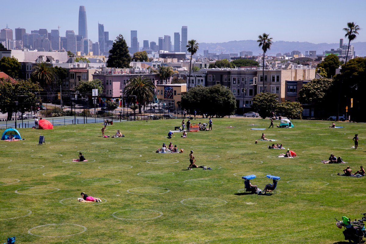 Park goers sit in social distancing circles at Dolores Park on Memorial Day in San Francisco, May 25, 2020. Photo by Anne Wernikoff for CalMatters