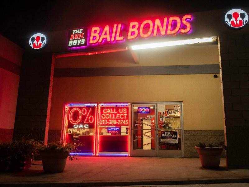 "The Bail Boys bail bonds displays a ""No on Prop 25"" poster in downtown Los Angeles. The proposition aims to end California's current cash bail system . Photo by Tash Kimmell for CalMatters."