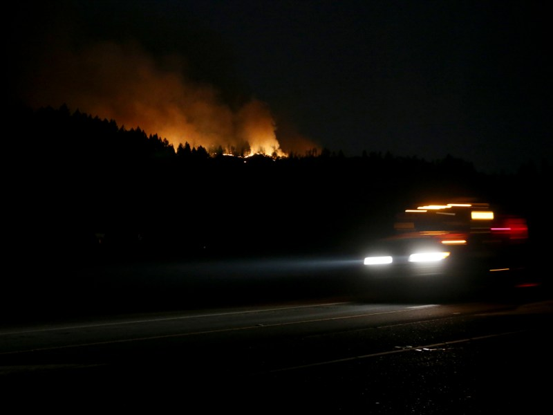 The Glass Fire burns near Diamond Mountain as a Cal Fire truck passes by about 3.5 miles from downtown Calistoga on Oct. 1, 2020. Photo by Jane Tyska, Bay Area News Group