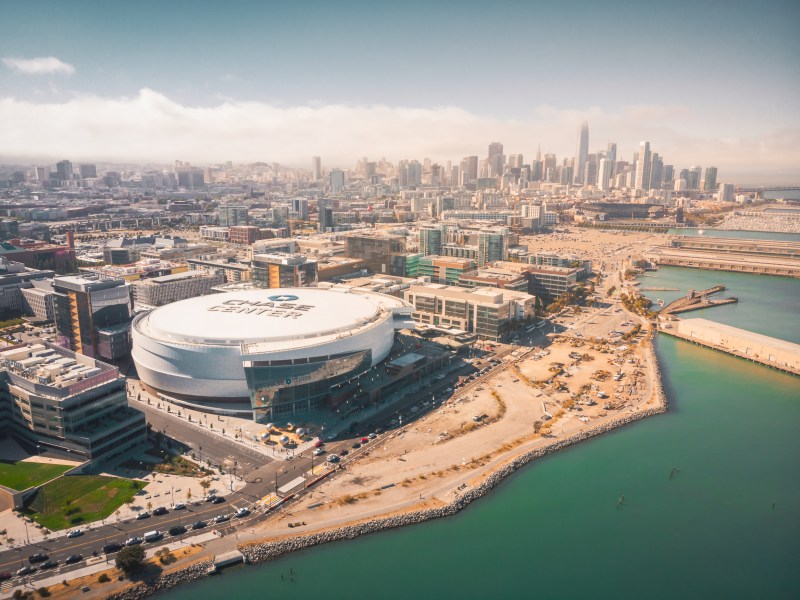 Aerial View of the Chase Center Warriors Arena and the San Francisco Skyline. Image via iStock