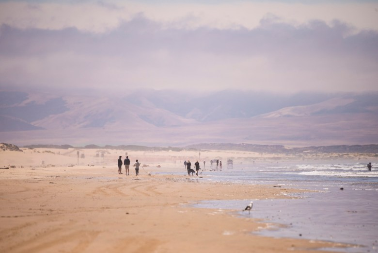 The dunes and mountains seen from the beach on July 21, 2020. Photo by Brittany App for CalMatters