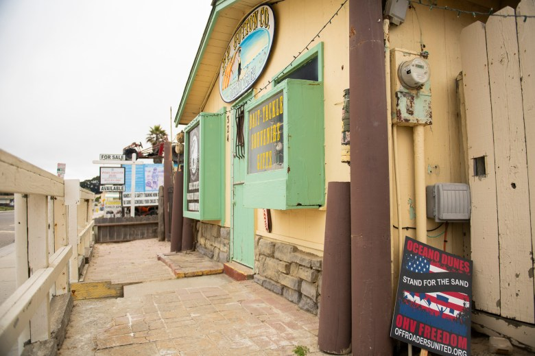 A sign for Off Roaders United, an organization supporting the right to operate off highway vehicles on dunes, mountains and trails across California, outside of a local fishing and souvenir shop in Oceano Beach on July 21, 2020. Photo by Brittany App for CalMatters