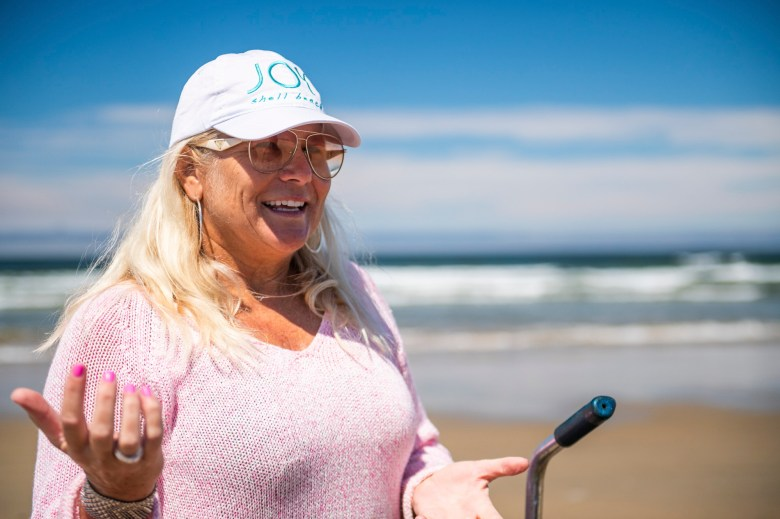 Jeanette Trompeter, who grew up riding off road vehicles at Oceano Dunes, has enjoyed exploring the beach as a pedestrian now that vehicles are barred from the dunes. Photo by Brittany App for CalMatters