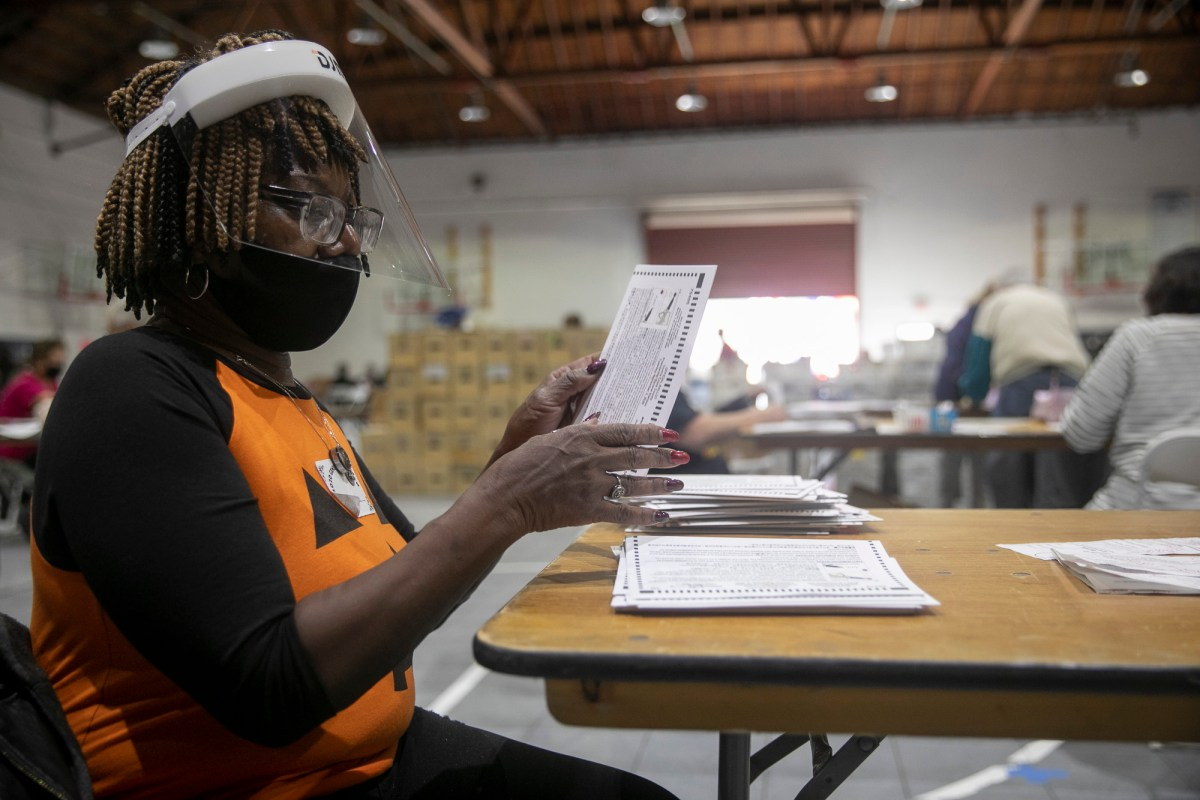 Oakley resident Gwendolyn Ward extracts ballots in Martinez on Oct. 31, 2020. Ward has been a poll worker and ballot extractor for more than 10 years. Photo by Anne Wernikoff for CalMatters