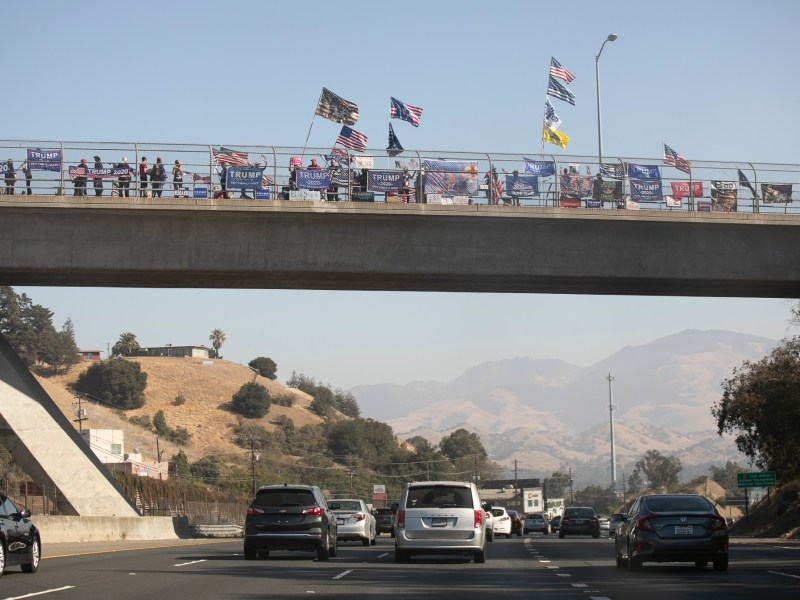 Trump supporters hold a rally on an overpass over route 24 outside of Walnut Creek on Oct. 31, 2020. Photo by Anne Wernikoff for CalMatters