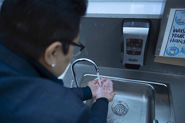Frances Esparza, the Superintendent of the El Rancho Unified School District, runs tap water from a new filtration system at Magee Elementary in Pico Rivera, CA, on Nov. 6, 2020. Photo by Tash Kimmell for CalMatters