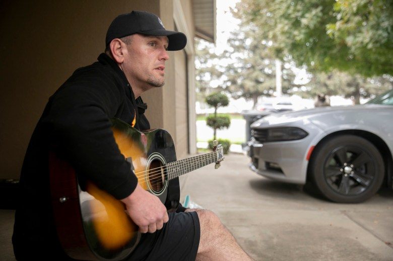 Matt Hoffman, seen at his girlfriend's home in Escalon on Nov. 13, 2020, spends his days sitting on the porch whereas on maintain with EDD, <a href=