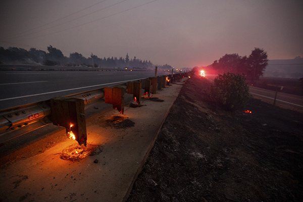 Hot spots continue burning guardrails after the LNU Lightning Complex fire jumped on I-80 freeway forcing to shut it down in both directions in Fairfield on Aug., 19, 2020. Photo by Ray Chavez, Bay Area News Group