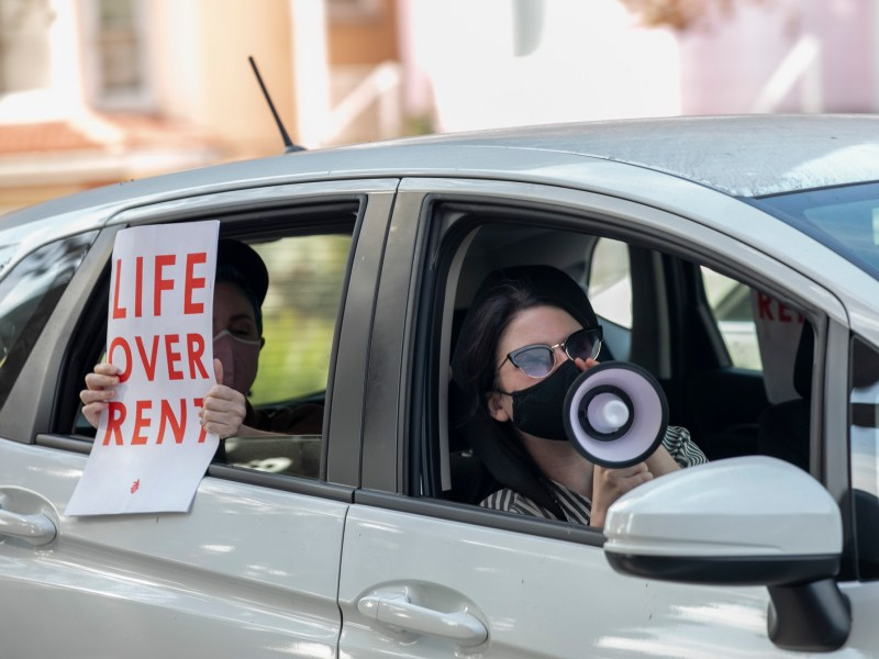 Demonstrators participate in a caravan along Harrison Street in Oakland to protest rent payment and evictions during the coronavirus pandemic on Dec. 5, 2020. Photo by Anne Wernikoff for CalMatters