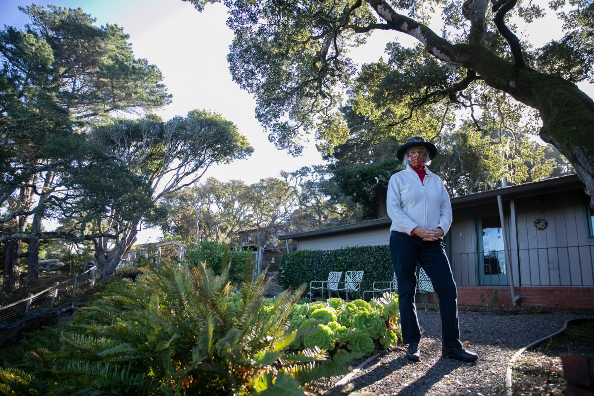 Lucy Smallreed at her home in Inverness on Dec. 6, 2020. Smallreed's neighborhood, which borders on the Tomales Bay State Park, is a heavily wooded area. Photo by Anne Wernikoff for CalMatters