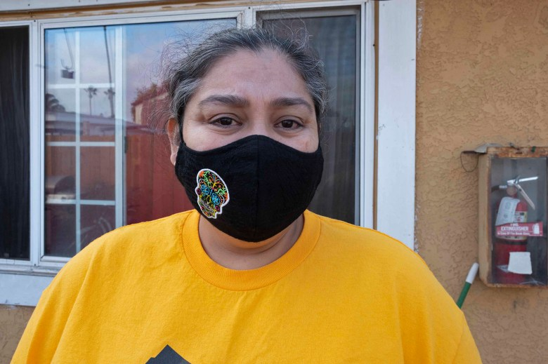 Patricia Mendoza fights back tears while speaking about the possibility of eviction on Dec. 10, 2020. Photo by Tash Kimmell for CalMatters.