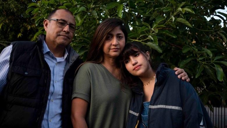 The Aleman family in the backyard of their home in Reseda, CA, on Dec. 17, 2020.