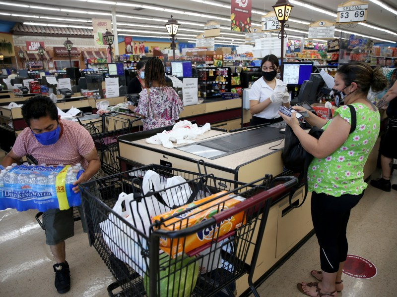 California grocery workers are pushing for stores to restore 'hero pay' as the pandemic drags on. In this file photo, people check out at the Cardenas Markets grocery store in Oakland on May 27, 2020. Photo by Jane Tyska, Bay Area News Group