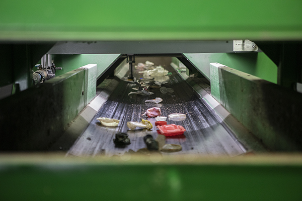 Non-recyclable items pass through a sorting machine in the trash facility at greenwaste on July 29, 2019. Photo by Anne Wernikoff for CalMatters