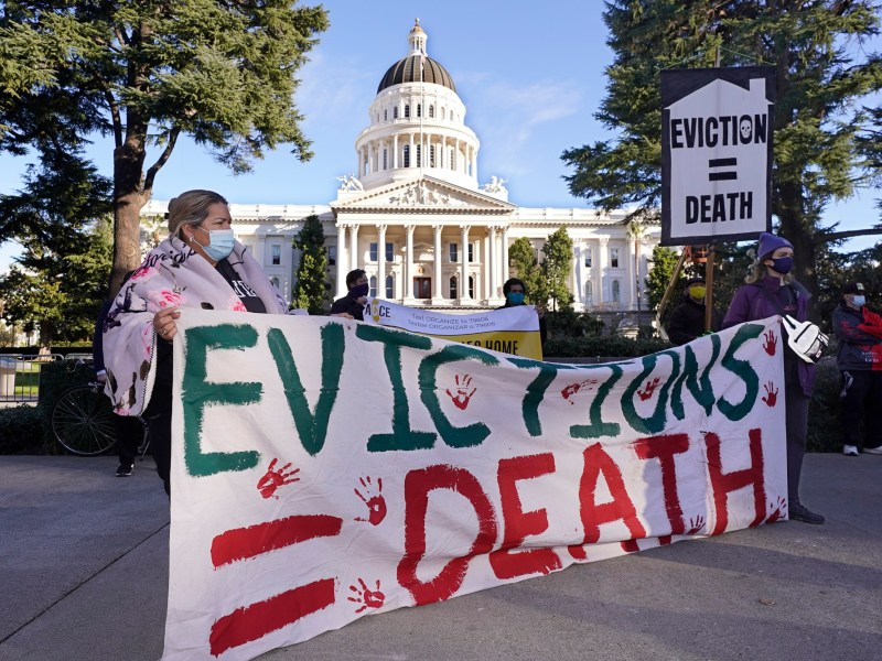 Demonstrators calling for lawmakers and Gov. Gavin Newsom to pass rent forgiveness and stronger eviction protections legislation gather in front of the Capitol in Sacramento on Jan. 25, 2021. Photo by Rich Pedroncelli, AP Photo