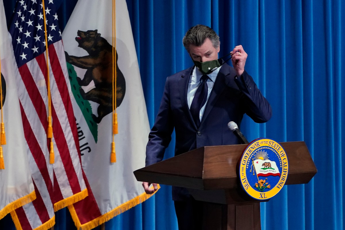 California Gov. Gavin Newsom remove his face mask before presenting his 2021-2022 state budget proposal during a news conference in Sacramento, Jan. 8, 2021. Photo by Rich Pedroncelli, AP Photo/Pool