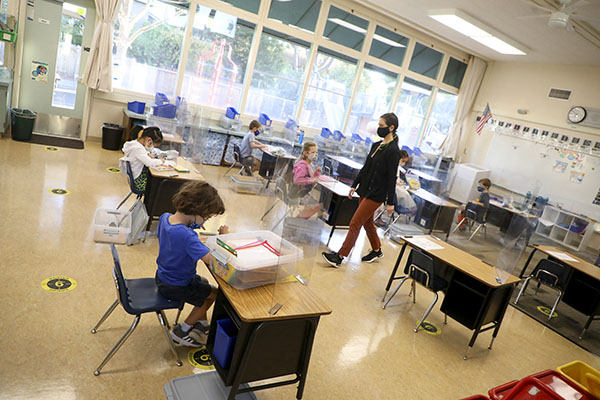 Kindergarten teacher Jessica Clancey, center, walks through her classroom at Barron Park Elementary School on Oct. 19, 2020, in Palo Alto. Photo by Aric Crabb, Bay Area News Group