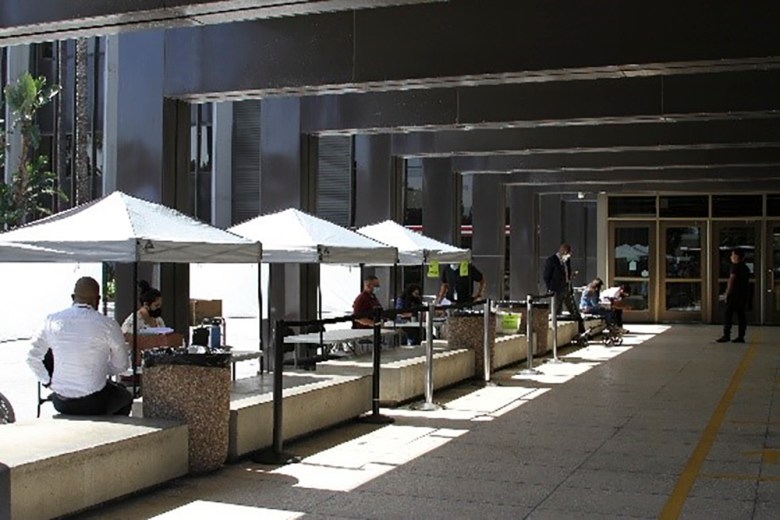Triage booths set up outside of the Orange County Superior Court to allow people to ask questions and interact with courthouse staff without having to go inside. Photo courtesy of Orange County Superior Court