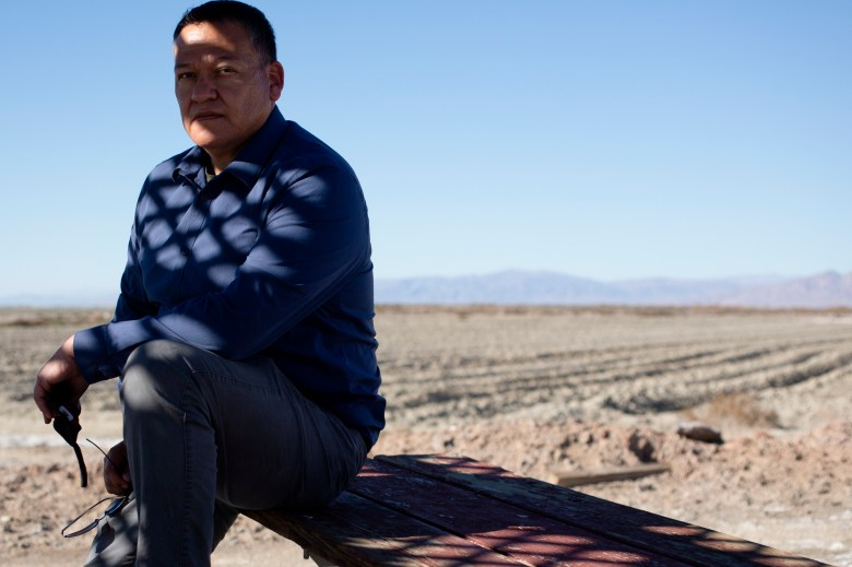 Luis Olmedo, executive director of Comite Civico Del Valle, sits for a portrait near a dried portion of the Salton Sea in Brawley on Feb. 5 2021. Photo by Shae Hammond for CalMatters