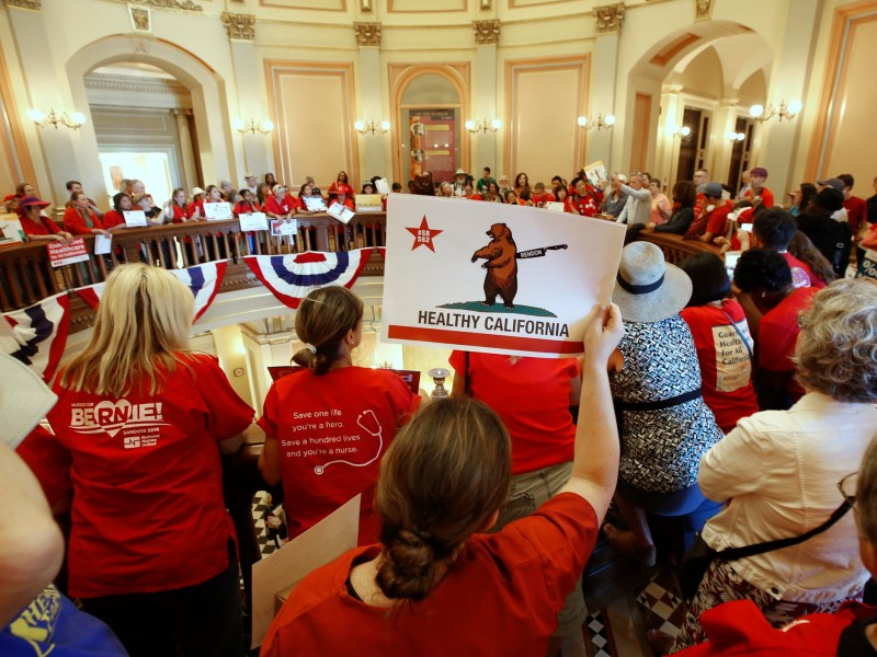 Members of the California Nurses Association and supporters rally at the State Capitol calling for a single-payer health plan on June 28, 2017, in Sacramento. When running for governor in 2018, Gavin Newsom vowed to implement single payer healthcare and the pressure is mounting to make good on that promise. Photo by Rich Pedroncelli, AP Photo