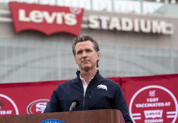 Gov. Gavin Newsom speaks at a press conference outside of Levi's Stadium before the opening of the largest mass vaccination site in the state on Feb. 9, 2021. Photo by Karl Mondon, Bay Area News Group