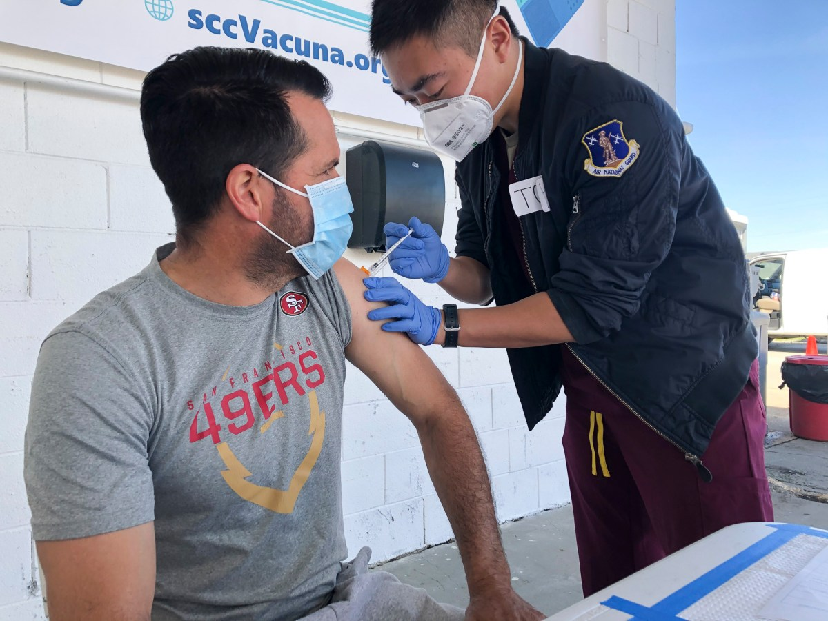 Mauricio Chavez of Hollister gets a COVID-19 vaccine at Monterey Mushrooms in Morgan Hill on Feb. 28, 2021. He works at a neighboring mushroom farm. Photo by Ana Ibarra, CalMatters