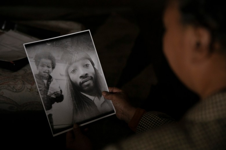 Kello Gordon looks at a photo of her son David Lee Williams in her Sacramento home on March 5, 2021. Williams has been in Sacramento County Jail for two years awaiting trial. Photo by Anne Wernikoff, CalMatters