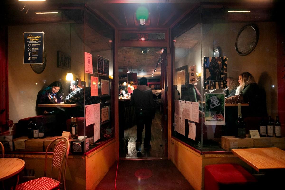 Diners are seen through the window at Etcetera in San Francisco on March 7, 2021. Restaurants were permitted to re-open for indoor dining starting last week. Photo by Anne Wernikoff, CalMatters
