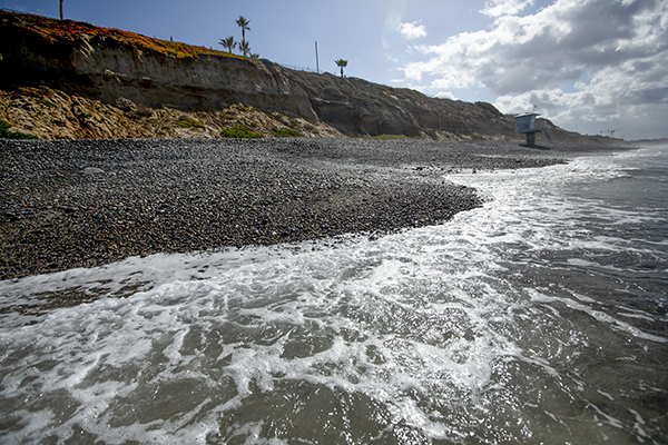 Powerful seas and cliff erosion threaten the beach at South Carlsbad State Beach on March 3, 2021. Photo by Shae Hammond for CalMatters
