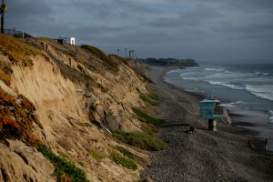Geo textile, installed a decade ago to address erosion, is seen against the cliffside at Carlsbad State Beach on March 3, 2021. Photo by Shae Hammond for CalMatters