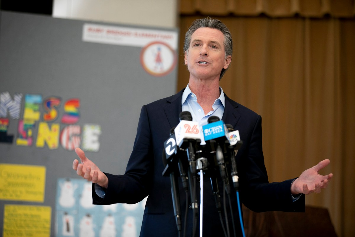 """Gov. Gavin Newsom speaks to the press during a visit to Ruby Bridges Elementary School in Alameda on March 16, 2021. """"We will fight it. We will defeat it,"""" Newsom said of the recall effort. Photo by Anne Wernikoff, CalMatters"""