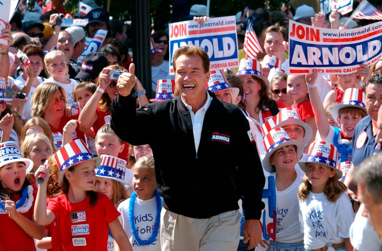 Republican candidate for California governor Arnold Schwarzenegger walks up the steps to the state Capitol during a campaign rally in Sacramento on Oct. 5, 2003. The prospect of a recall election is reminiscent of California's circus-like 2003 recall, in which voters installed Schwarzenegger as governor after deposing the unpopular Democrat Gray Davis. Photo by Steve Yeater, AP Photo