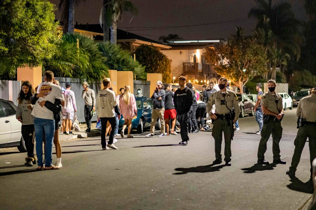 Maskless students exit a house party in Isla Vista on Aug. 29, 2020 shortly after it was shut down by the Santa Barbara County Sheriff's Office for violating county public health guidelines. The start of fall quarter at UC Santa Barbara saw the return of house parties despite campus and local guidelines against gathering. Photo by Max Abrams