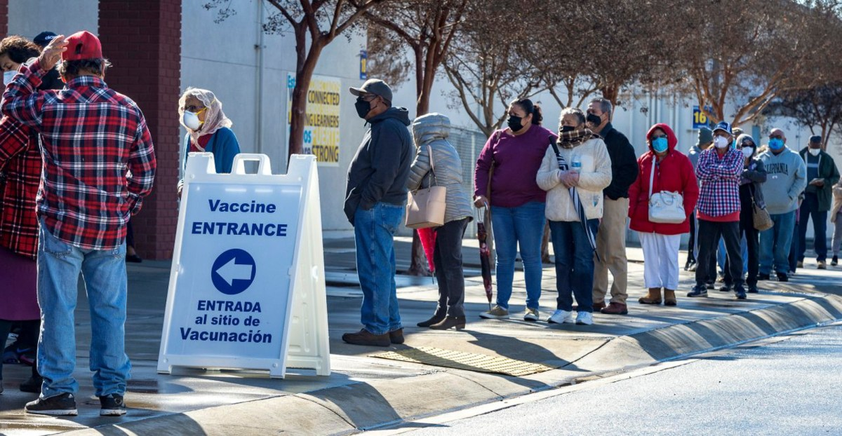 Santa Ana residents who were invited to a COVID-19 vaccination event by local school officials and community groups wait in line at Valley High School in Santa Ana on February 12, 2020. Photo by Mark Rightmire, Orange County Register/SCNG