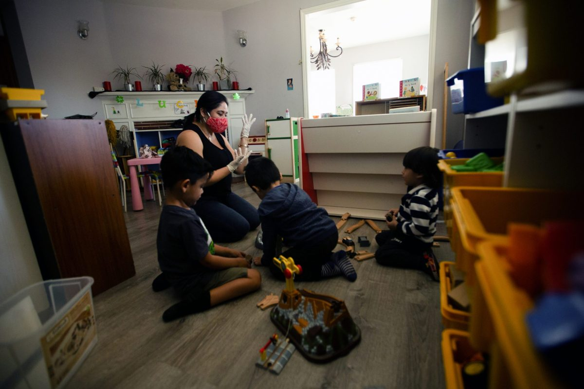 Silvia Hernandez plays with children at her daycare in Van Nuys on April 9,2021 photo by Shae Hammond for CalMatters