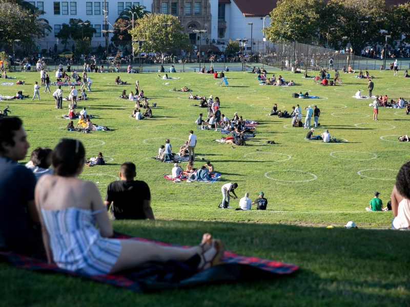 Park-goers enjoy the sunshine at Dolores Park on the Fourth of July in San Francisco on July 4, 2020. Photo by Anne Wernikoff, CalMatters
