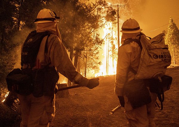 Wind and flames leap high in the air as firefighters attempt to put out the Creek Fire Northeast of Shaver Lake in Fresno County on Sep. 6, 2020. Photo by David Rodriguez, The Salinas Californian