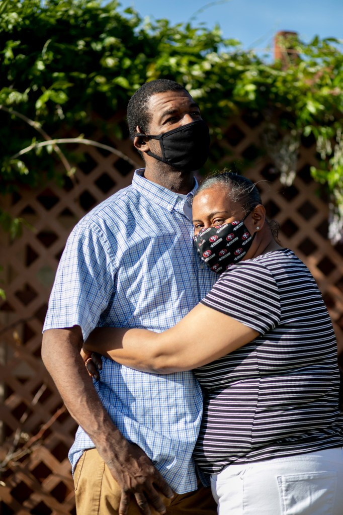Stacy Estes with his fiancée in front of their home in Sacramento on April 7, 2021. Estes owes about $47,000 in child support debt to the state. Photo by Anne Wernikoff, CalMatters