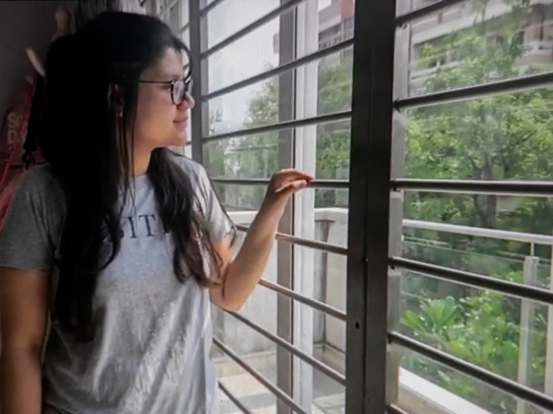 UC Irvine student Yutika Khemka photographed via Zoom in her bedroom in Kolkata. Khmeka isn't certain if the vaccines currently available in India will qualify her to return to campus in the fall but she says she will take whichever vaccine she can get. Photo by Anne Wernikoff, CalMatters