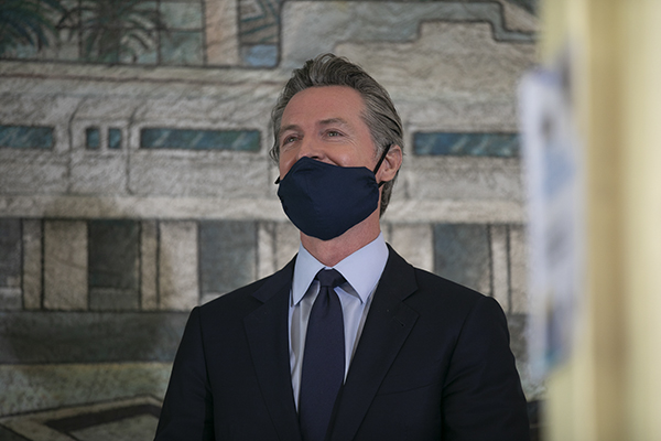 Gov. Gavin Newsom holds a press conference at The Unity Council in Oakland to announce an estimated $75.5 billion surplus and in addition to stimulus checks, tax rebates and additional rent relief on May 10, 2021. Photo by Anne Wernikoff, CalMatters