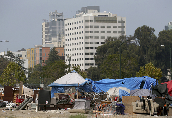 An encampment along East 12th Street and Lake Merritt Boulevard in Oakland on Sept. 15, 2020. Gov. Newsom just announced a $12 billion package expanding on pandemic emergency responses to help end homelessness. Photo by Jane Tyska, Bay Area News Group
