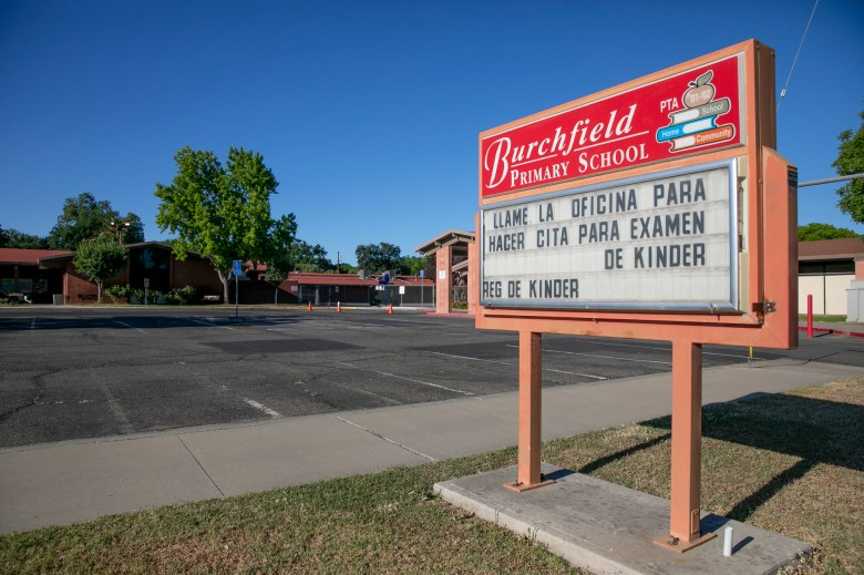 The Burchfield primary school marquee written in Spanish and English informing parents to call the school office to make a kindergarten entrance exam appointment in Colusa on May 25, 2021. Photo by Anne Wernikoff, CalMatters