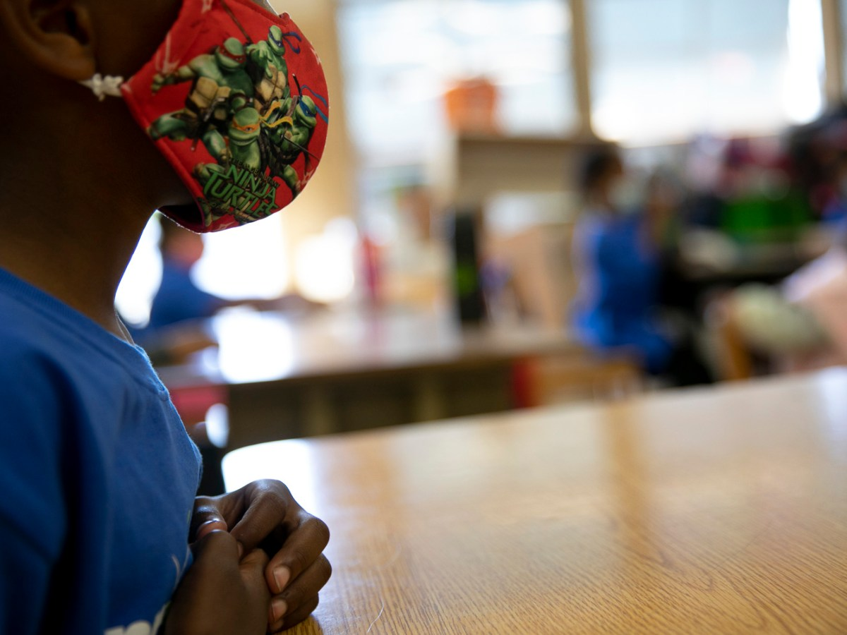 Students wear masks and sit one to a two-person desk in order to social distance during summer classes at Laurel Elementary in Oakland on June 11, 021. Photo by Anne Wernikoff, CalMatters