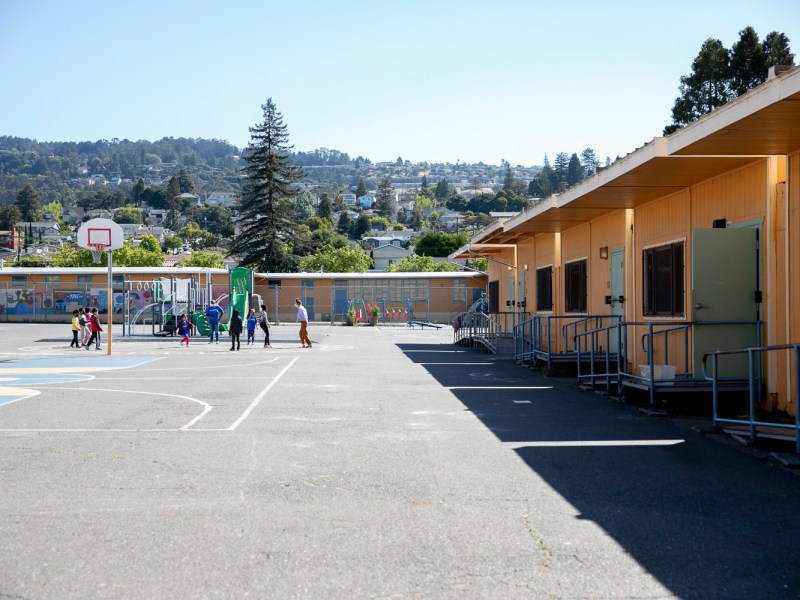 Students and teachers play on the playground at Laurel Elementary during summer session classes in Oakland on June 11, 2021. Photo by Anne Wernikoff, CalMatters