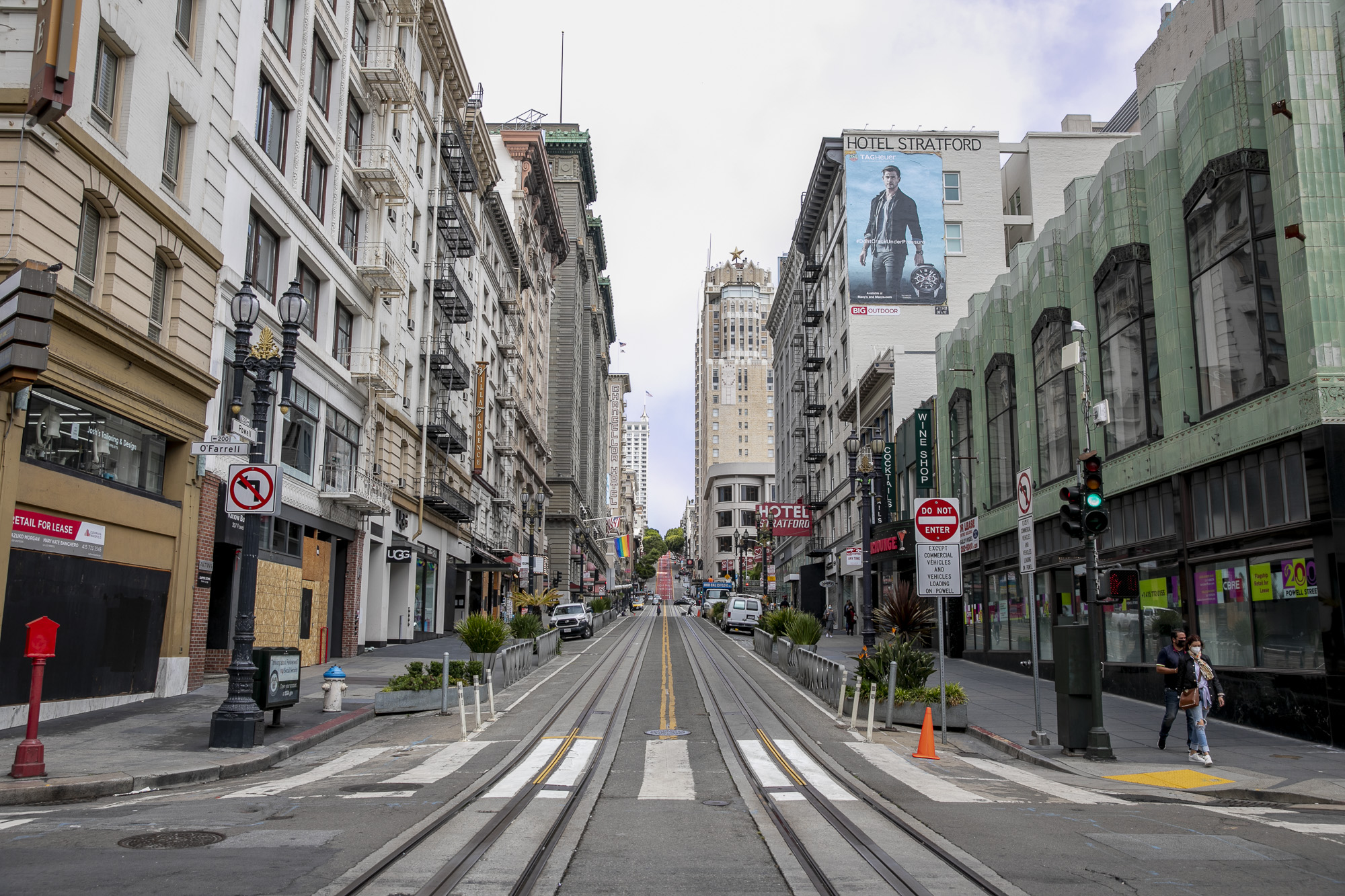 Pedestrians walk past vacant store fronts along Powell Street in the Union Square shopping district in San Francisco on June 14, 2021. Photo by Anne Wernikoff, CalMatters