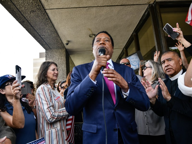Conservative radio talk show host Larry Elder, talks to his supporters at a rally in Norwalk, on July 13, 2021. Elder announced his bid as a recall candidate for governor of California. Pablo Unzueta for CalMatters