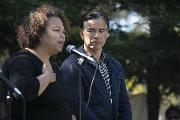 Then Assemblymember Rob Bonta looks on as his wife, Mia Bonta, speaks during a community event on April 18, 2021 in San Leandro, days before his confirmation as California Attorney General. Photo by Anne Wernikoff, CalMatters