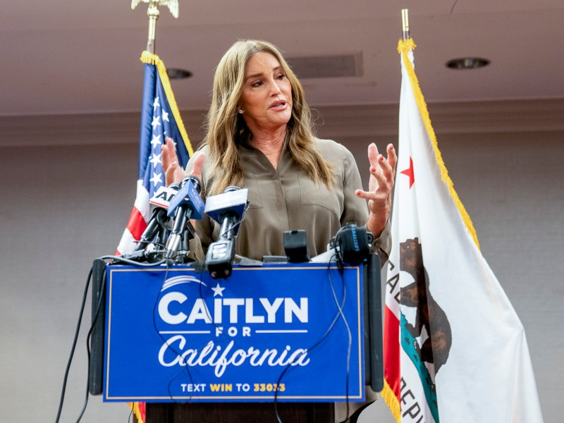 Caitlyn Jenner, a Republican candidate in the Gavin Newsom recall election, speaks to reporters at the Hyatt Regency in Sacramento on July 9, 2021. Photo by Marissa Garcia for CalMatters