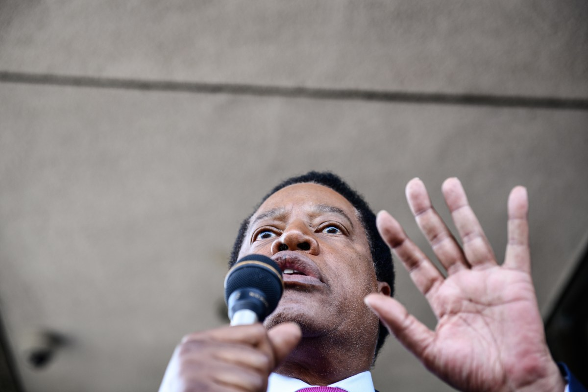 Conservative radio talk show host Larry Elder, speaks to his supporters during a rally in Norwalk, on July 13, 2021. Elder announced his bid as a recall candidate for governor of California. Pablo Unzueta for CalMatters