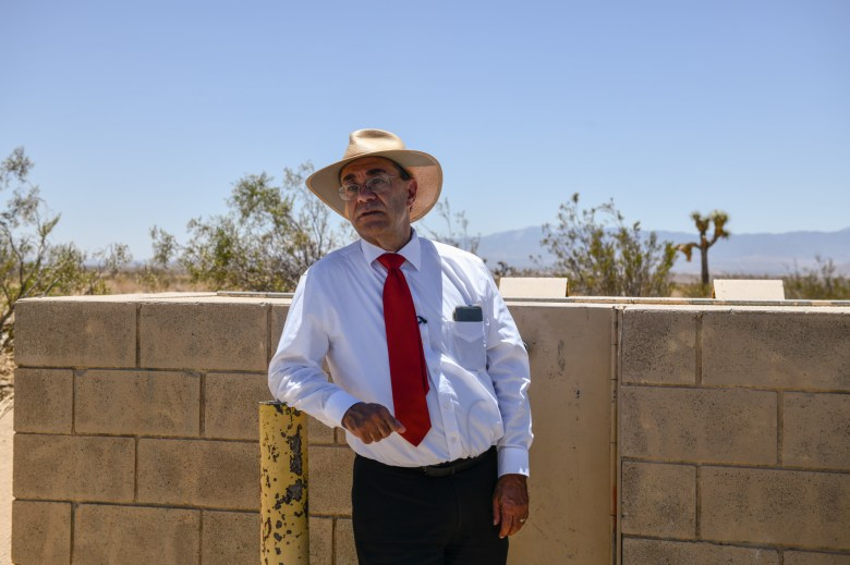 """Charles Bostwick, a field representative for Los Angeles County supervisor Kathryn Barger, stands near one of the vandalized water sources in Lancaster, on July 2, 2021. """"This has only been a problem for the last year, or year and a half."""" Bostwick said. Pablo Unzueta for CalMatters"""